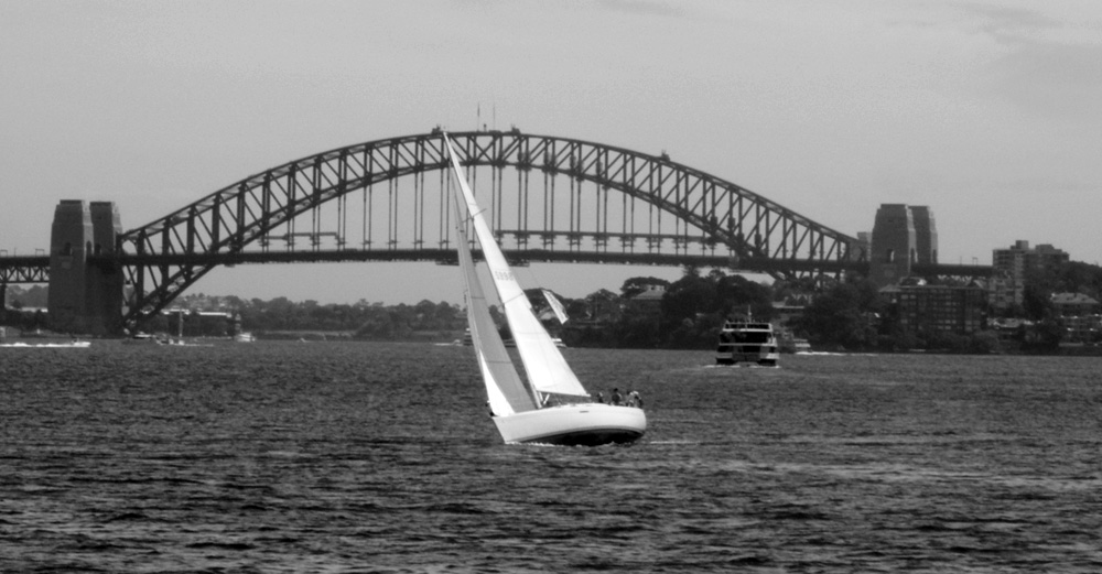 Sailing Boat in front of Bridge